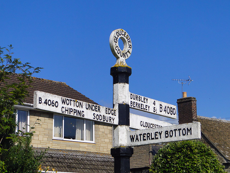 Signpost to quirky named places in North Nibley