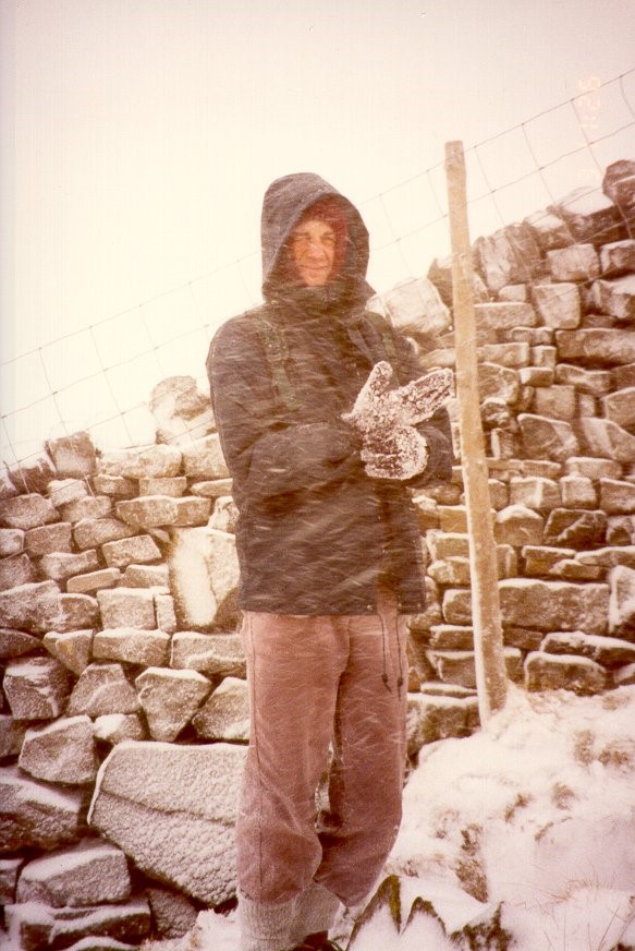 Dave takes shelter by a drystone wall