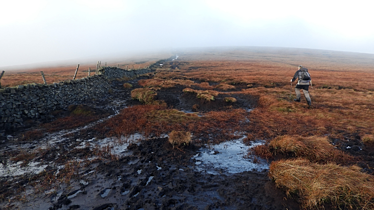 Crossing the bogs of Buckden Pike