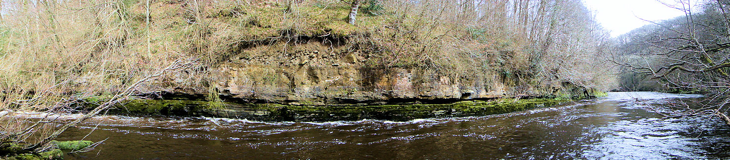 The River Ure bends round a rock face near Hack Fall