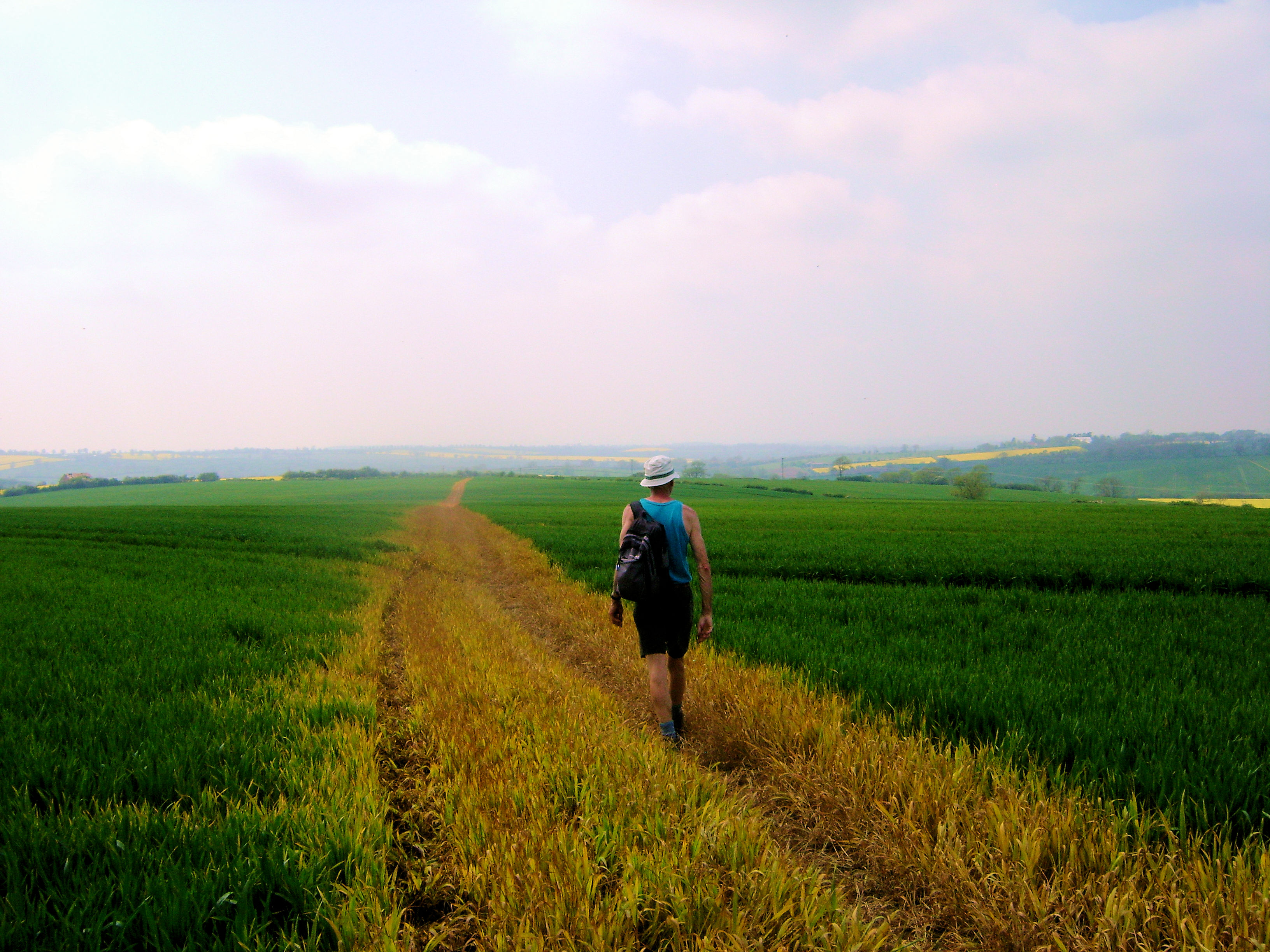 Ken crosses a large field on the way back