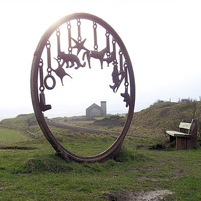 Coastal sculpture, old pump house and rail line to the mine