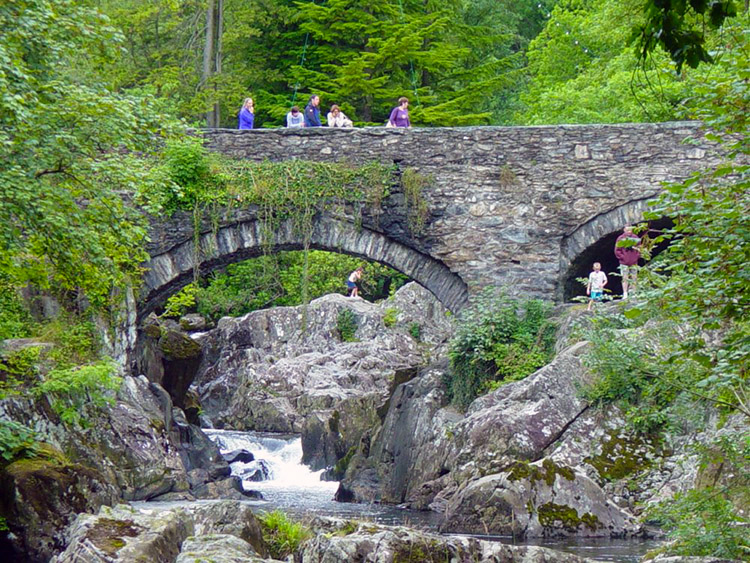 Tourists enjoy the scenery in Betws-y-Coed