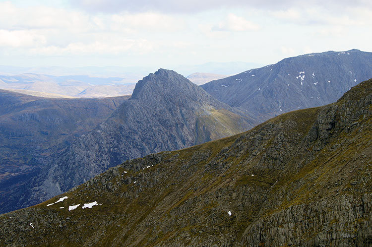 Tryfan appears over the shoulder of Carnedd Llewelyn
