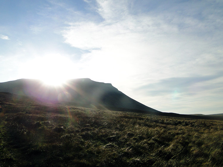 Sun glints over Ingleborough