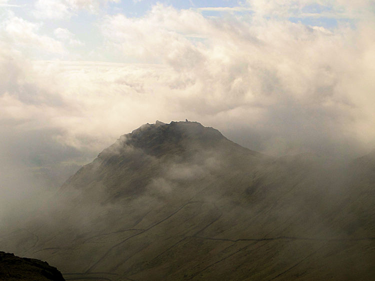 Helm Crag appears out of the mist