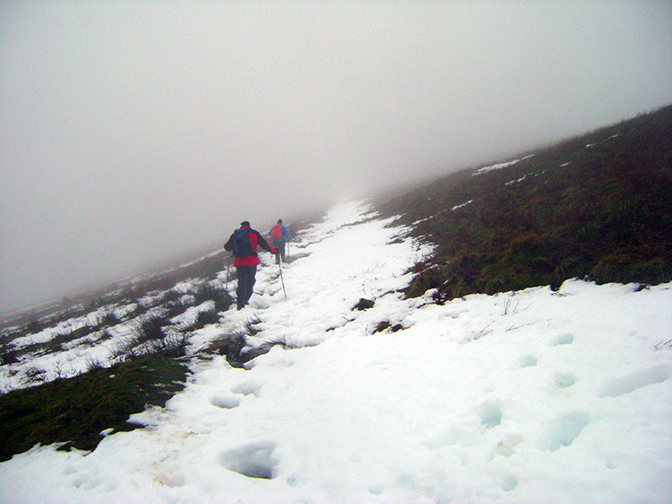 Trudging through melting snow into cloud