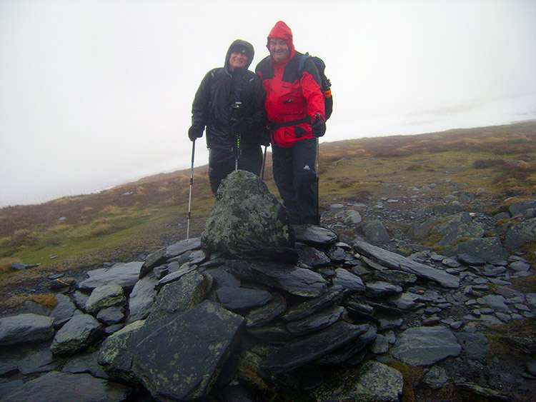 Bedraggled walkers on the summit of Bowscale Fell
