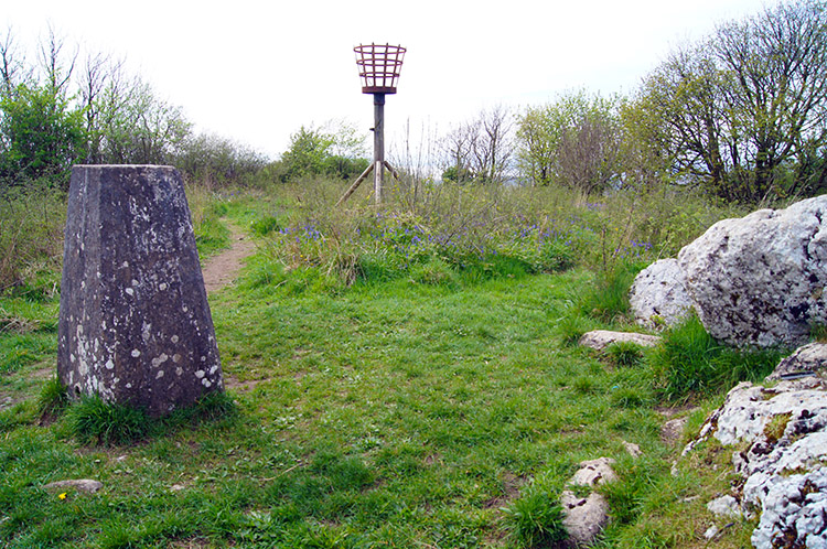 Trig point and signal beacon on Warton Crag