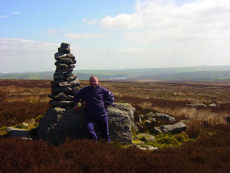Joe rests by a Cairn on Blubberhouses Moor