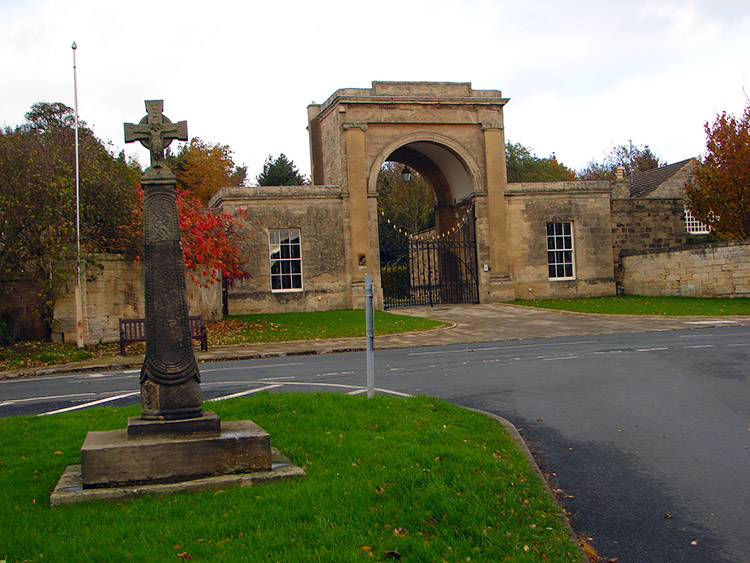 Rudding Gate and village cross in Follifoot