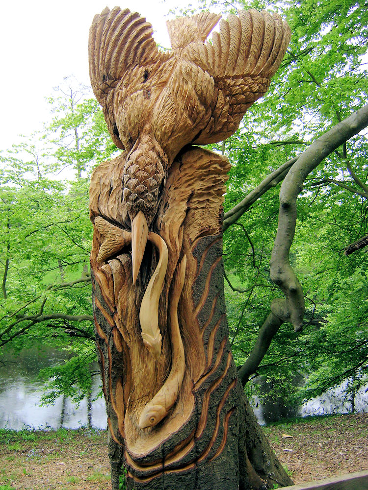 Wood sculpture of Kingfisher and Fish