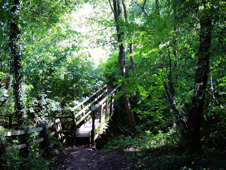 Footbridge indicating the way from Ercall Wood