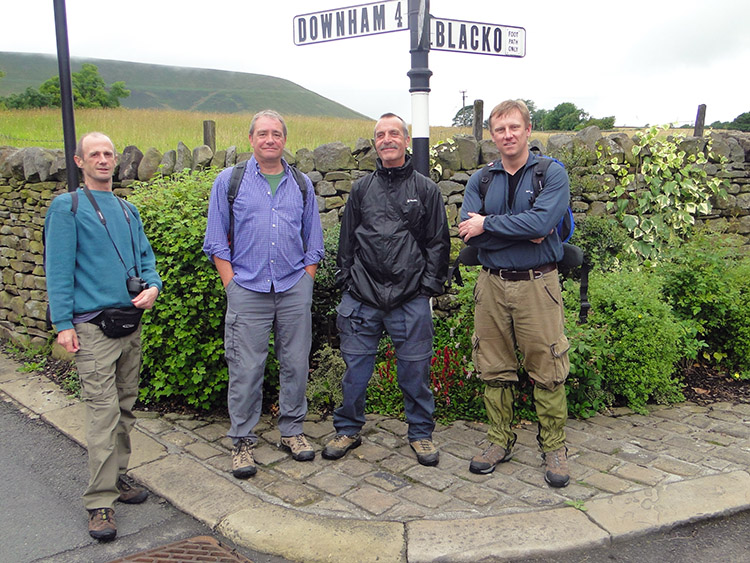 The boys pose at a signpost in Barley