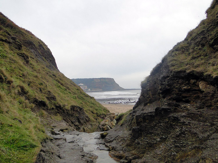 The ascent from Runswick Sands is via Hobb Holes