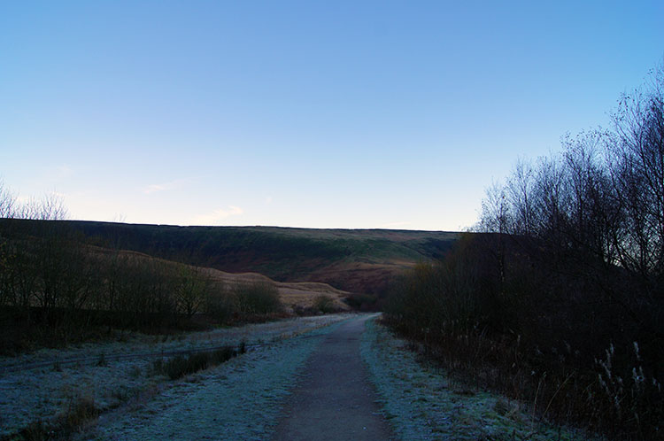 Setting off in winter shade along Longdendale Trail