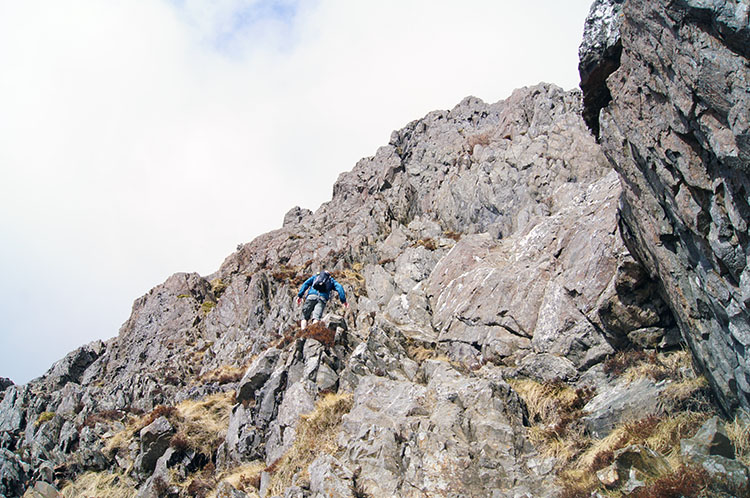 Adam continues to make progress up Crib Goch