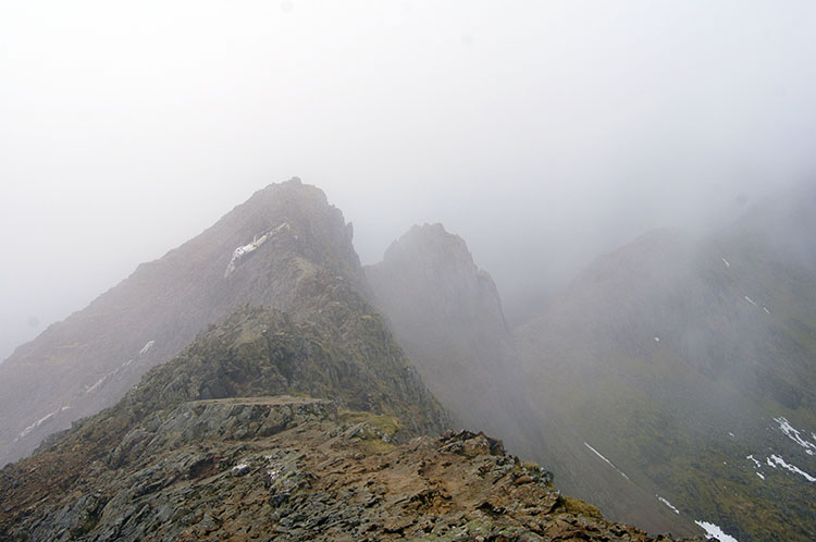 Cloud crosses over Crib Goch as we reach the top ridge