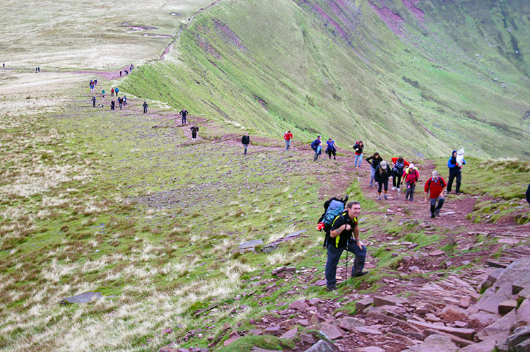 Walkers climbing to Corn Du from the Storey Arms track