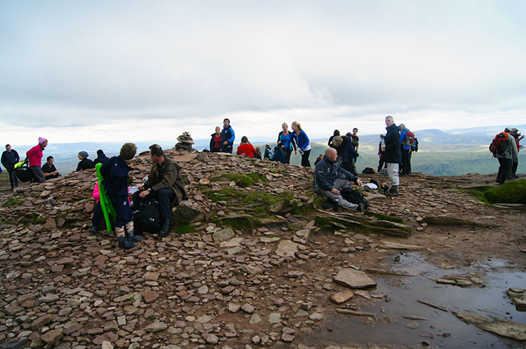 Relaxing after climbing to the summit of Corn Du