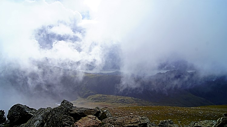 Cloud sweeping over the summit over Y Garn